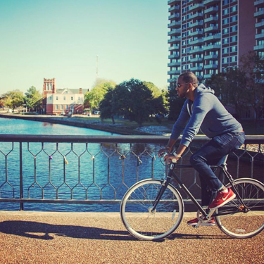 Man riding bike along Elizabeth River Trail.