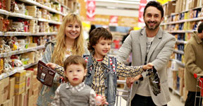 Parents and two children in shopping cart.
